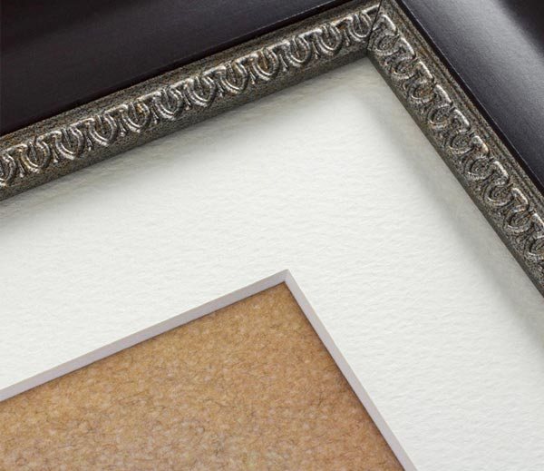 Photo frame with white bevelled mat